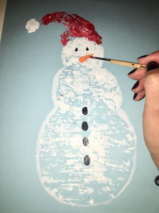 Etape 5: dessine les détails du bonhomme de neige