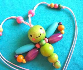 Collier papillon en perles